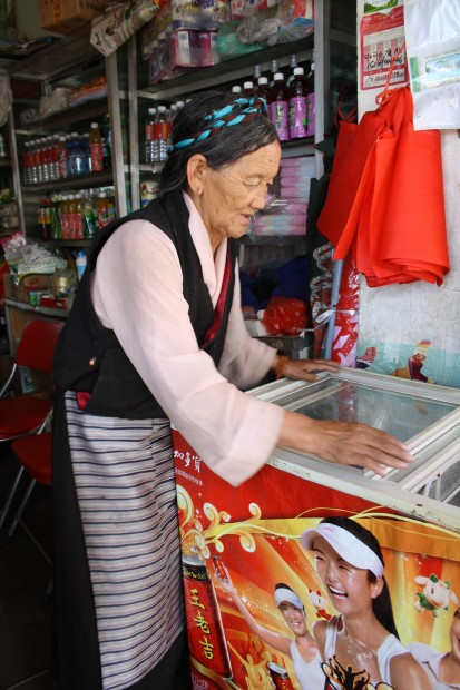 Elderly lady in a small shop next to the Sera Monastery in Lhasa, Tibet.