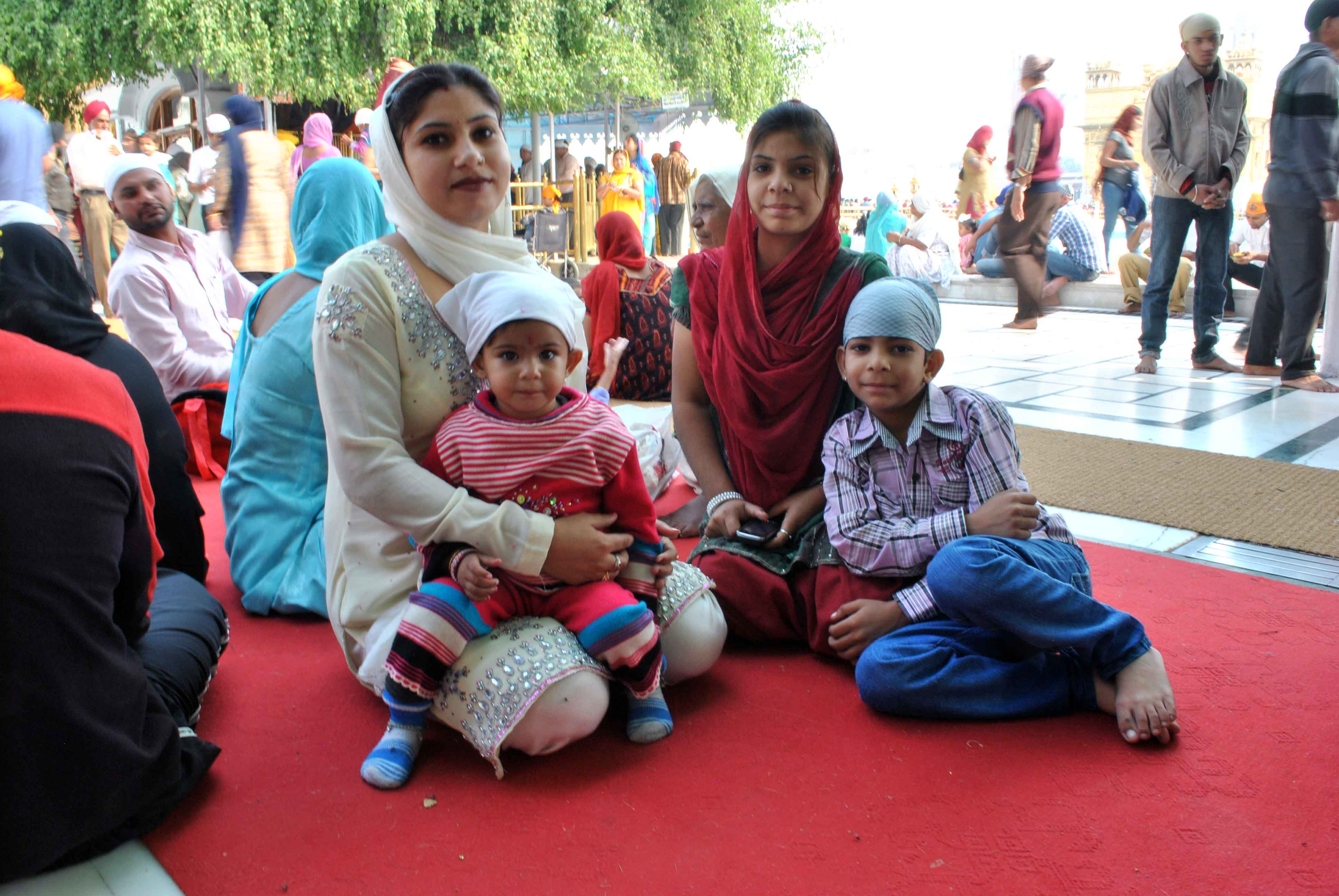 Mothers with children in the Golden temple, Amritsar