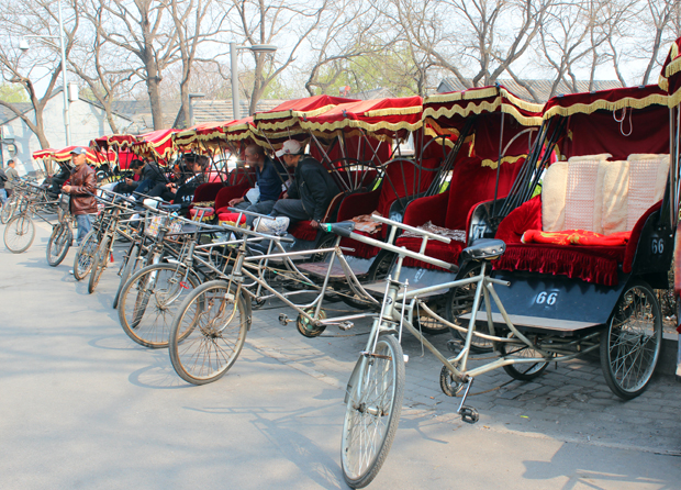 Rickshaws at a square next to the Bell Tower