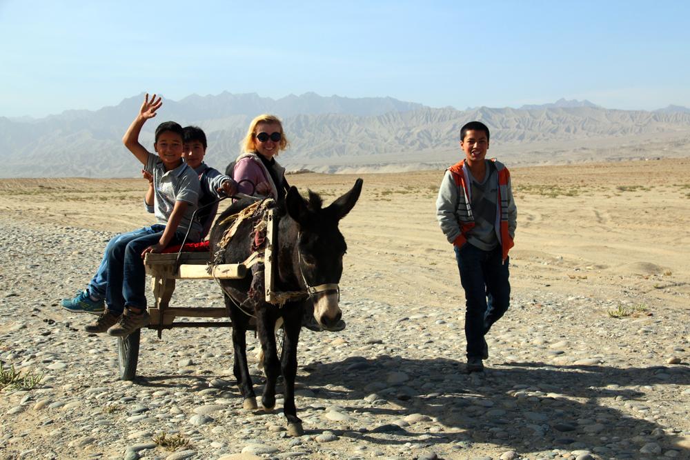Uyghur guides Hotan Taklamakan desert China Asia