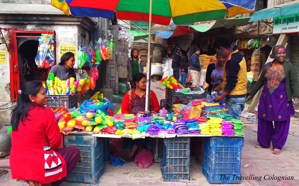 Travel blogger review 2017 Holi Festival street vendours selling colour packs Kathmandu Nepal Himalaya South Asia ASIA